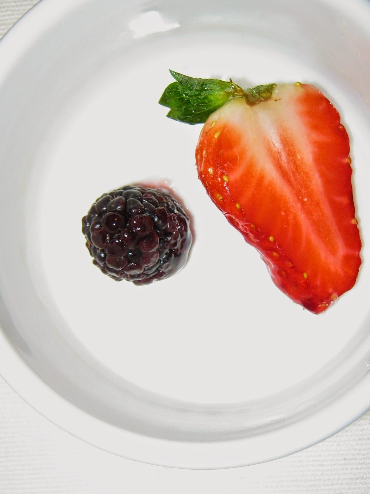 berries in a white plate