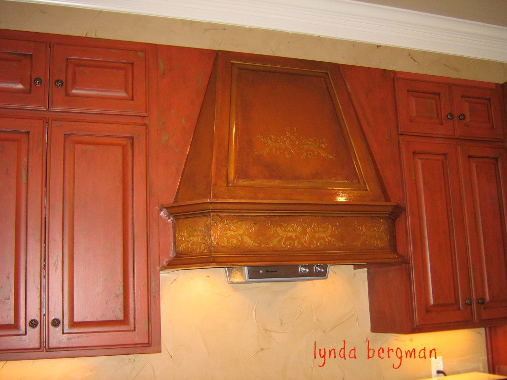 These cabinets, I painted red, distressed and applied and wiped off a