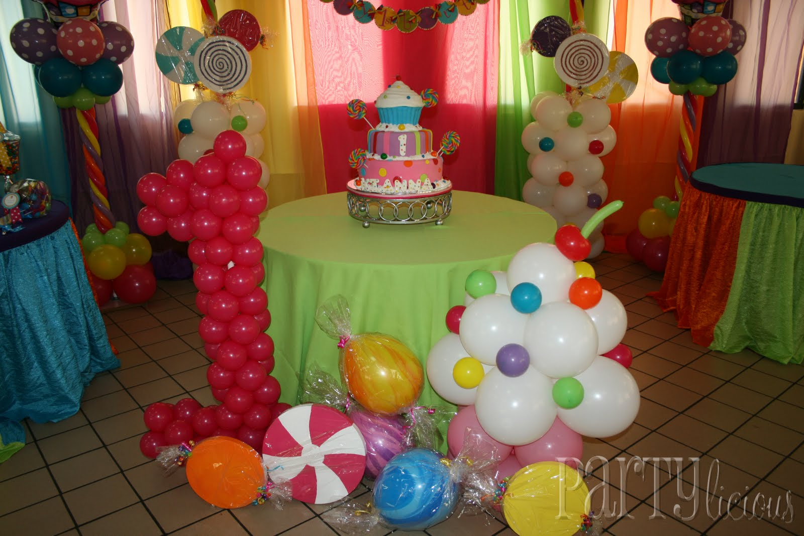 Partylicious events pr sweet 1st birthday candy cupcakes for Balloon birthday decoration