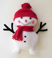 http://sewtoy.com/free-toy-sewing-pattern/sew-lumi-snowman-easy-free-pattern/