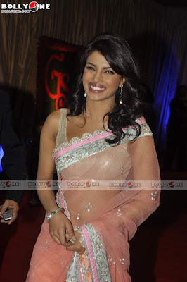 Actress Priyanka Chopra in an Orange Transparent Saree with Sleeveless Blouse