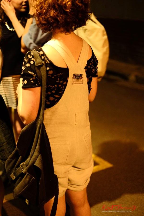 Bib shorts and print tee, army surplus web bag, in the queue for white rabbit opening.