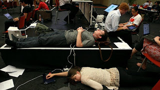 Tired delegates on the final day of negotiations of the COP17 Climate Change Conference in Durban.