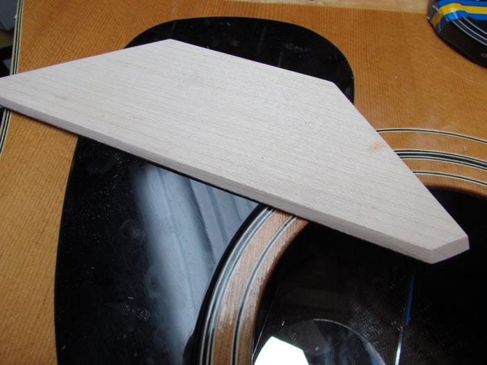 Acoustic guitar bridge plate