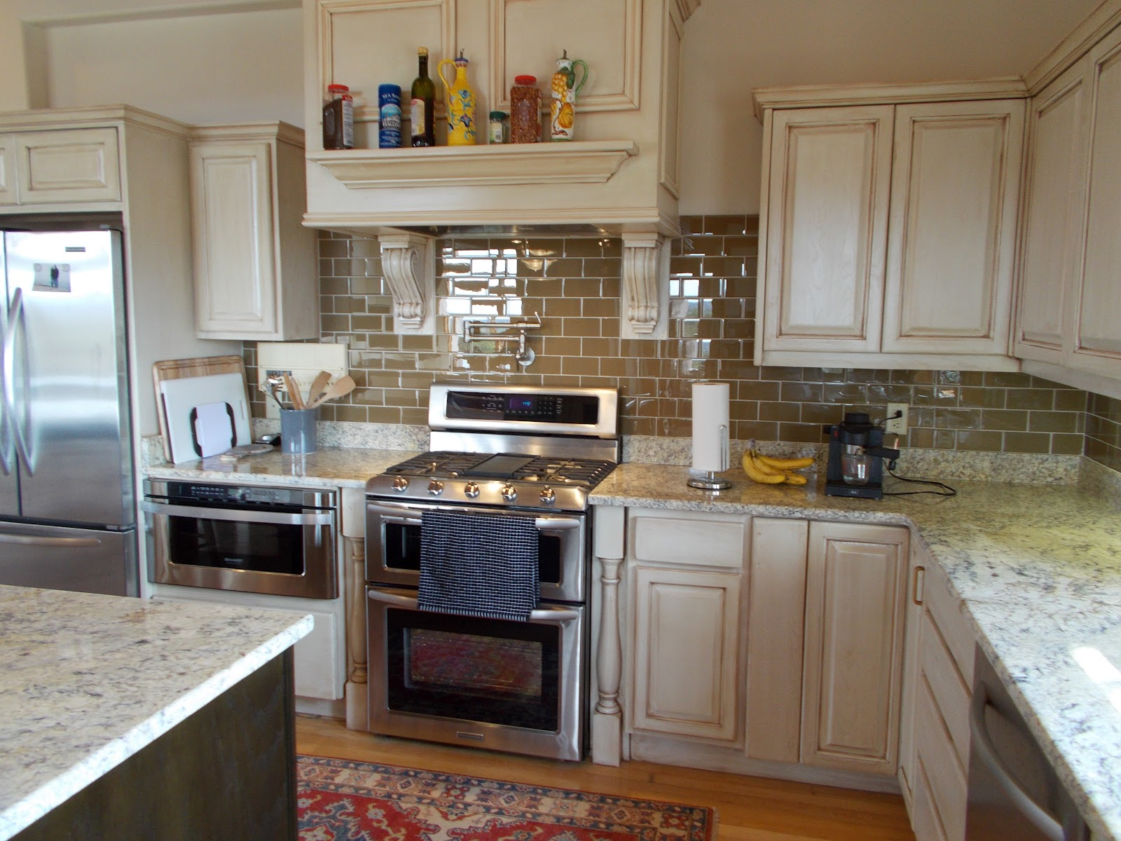 White Kitchen Cabinets Brown Countertops with Backsplash