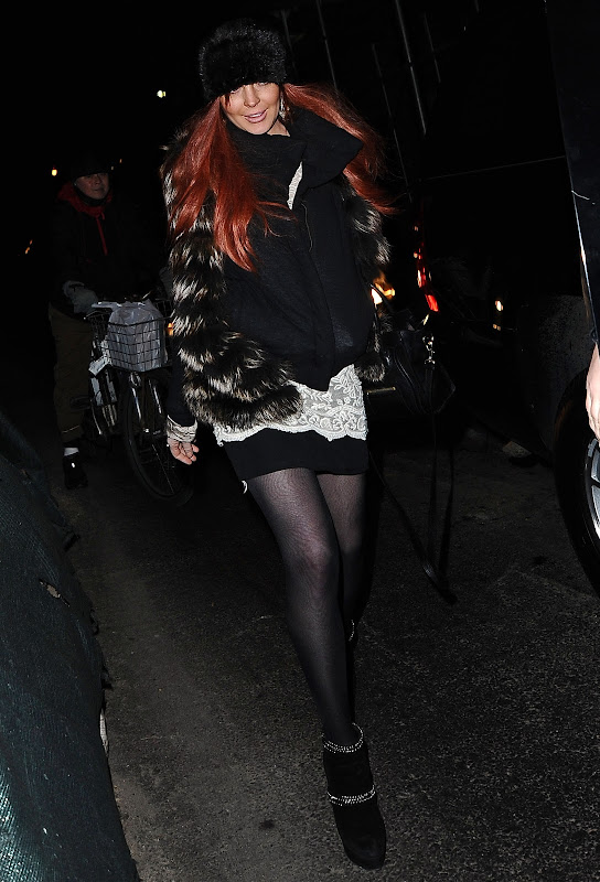 Lindsay Lohan leggy in front of her New York hotel