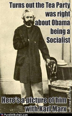 'Turns out the Tea Party was right about Obama being a socialist. Here he is with Karl Marx' photo of Marx with empty chair
