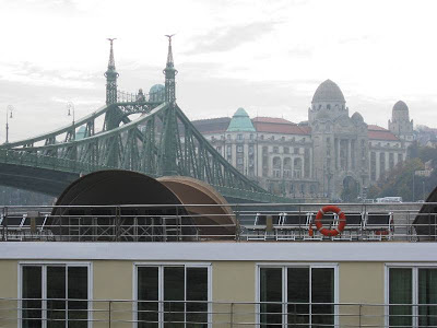 Ship with bridge and building by day