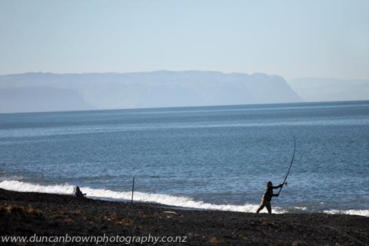 Surfcaster on Pacific Beach, Napier photograph