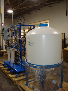 A storage tank made out of polypropylene that has a spray ball assembly being prepared for delivery