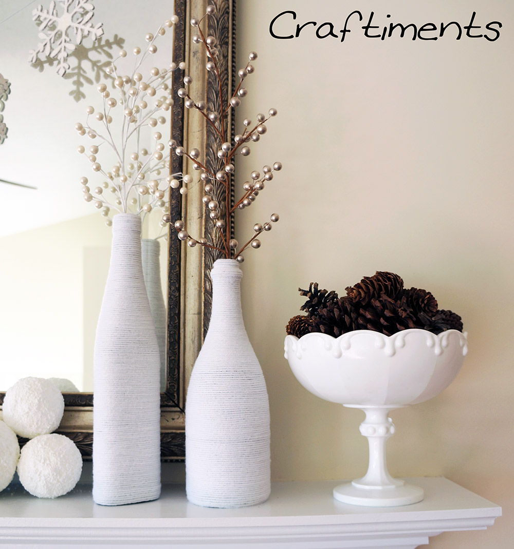 Craftiments:  Yarn wrapped bottles and milk glass pedestal bowl filled with pinecones