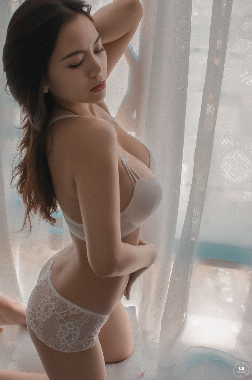 Archived: Sexy Asian Girl Sitting By The Window