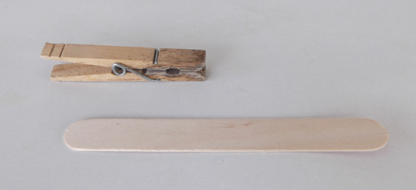 clothspin, popsicle stick, wood stick