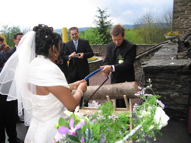 German wedding traditions sawing log