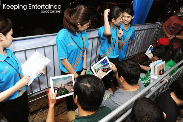 Customers keeping themselves entertained with the help of Celcom staff