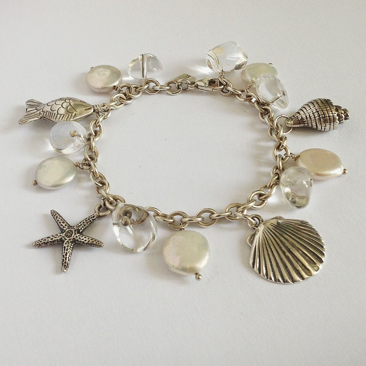 https://www.etsy.com/listing/191254500/beach-bracelet-clamshell-starfish-conch