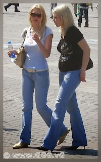 Girls in blue jeans on the street