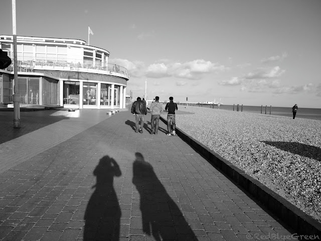 photo of walking path, cafe, shops at Brighton beach