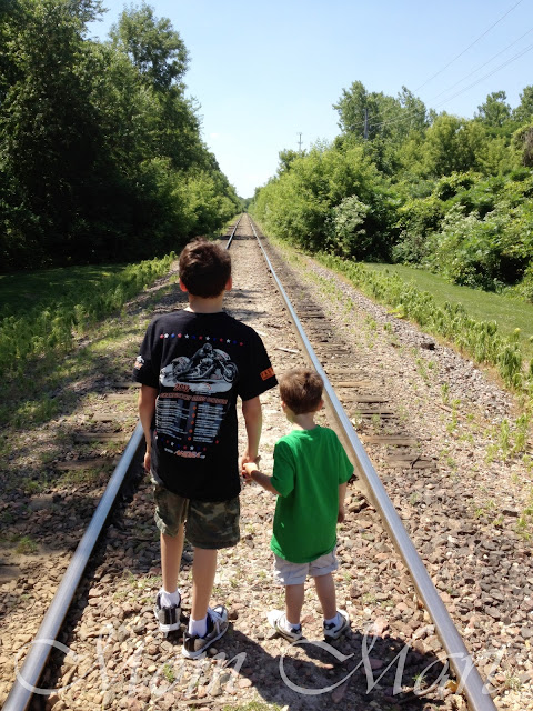 The boys playing on an abandoned railway