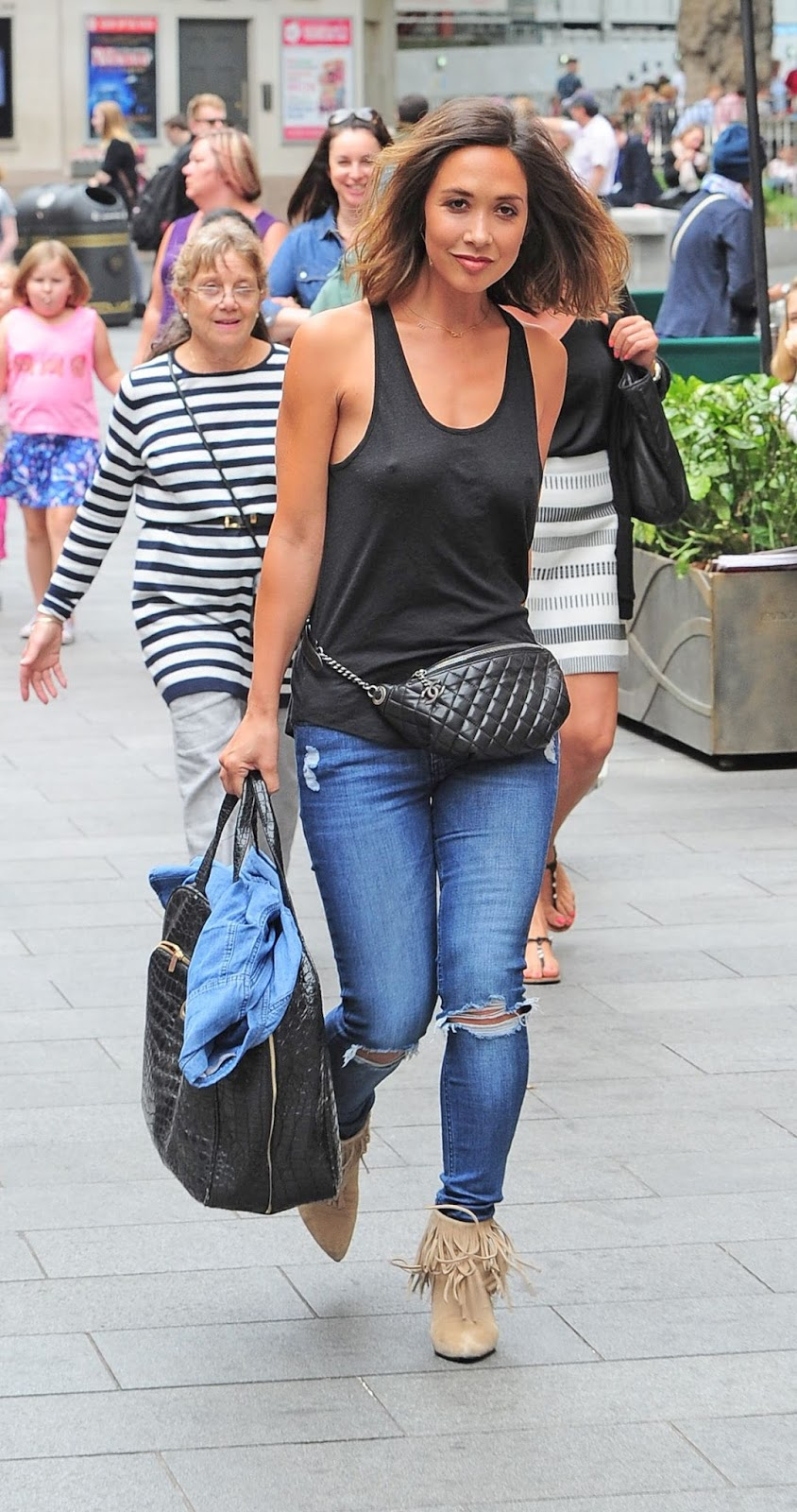 Myleene Klass goes braless in a low-cut vest top