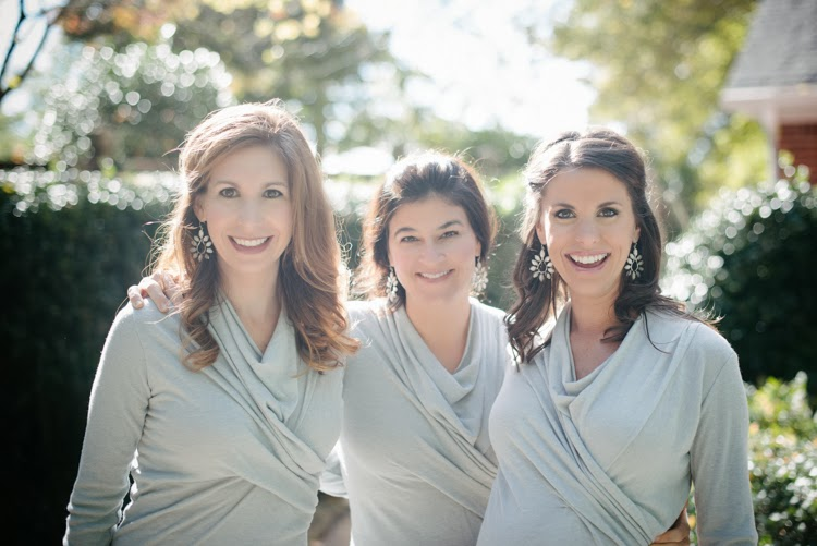 Bridesmaids wearing blue gray Rick Owens Lilies dress and smiling for the photograph