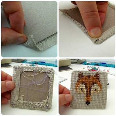 embroidered fox in a frame