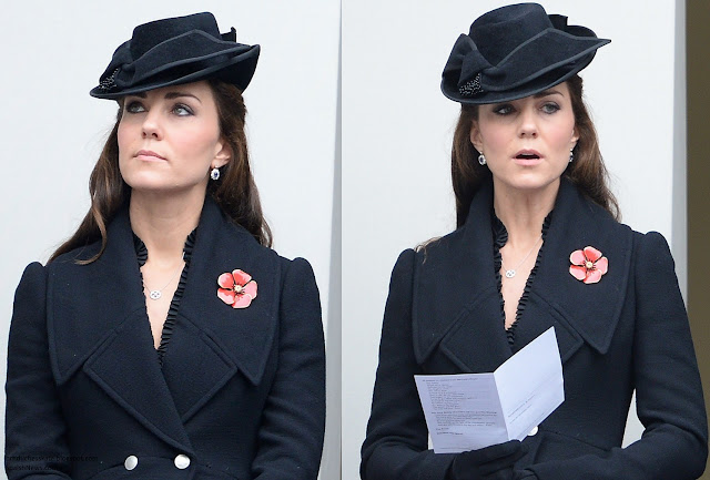 The Duchess wore Alexander McQueen Black flared wool coat.