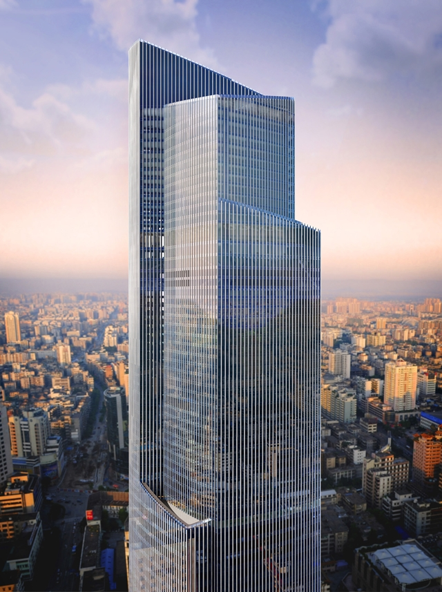 Picture of upper part of The Chow Tai Fook skyscraper with the city in the background