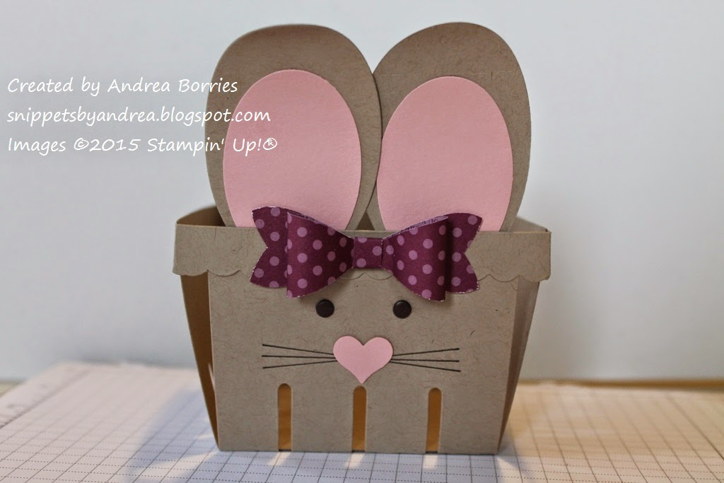 Bunny Basket Step 9. Use Bow Builder punch and DSP to make a bow. Adhere the bow to the basket.