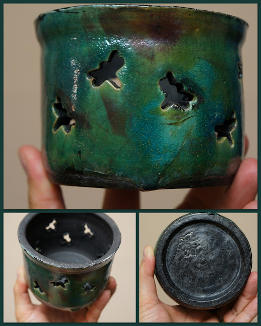 Raku pottery candleholder with dragonfly cutout pattern.