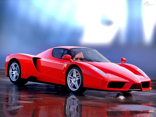 Red 2012 Ferrari Enzo parked on wet pavement
