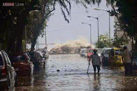 http://sciencythoughts.blogspot.co.uk/2014/06/flooding-after-mumbai-hit-by-freak-waves.html