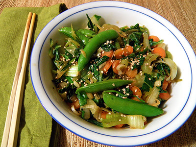 Bowl of stir fry with sesame seeds on top