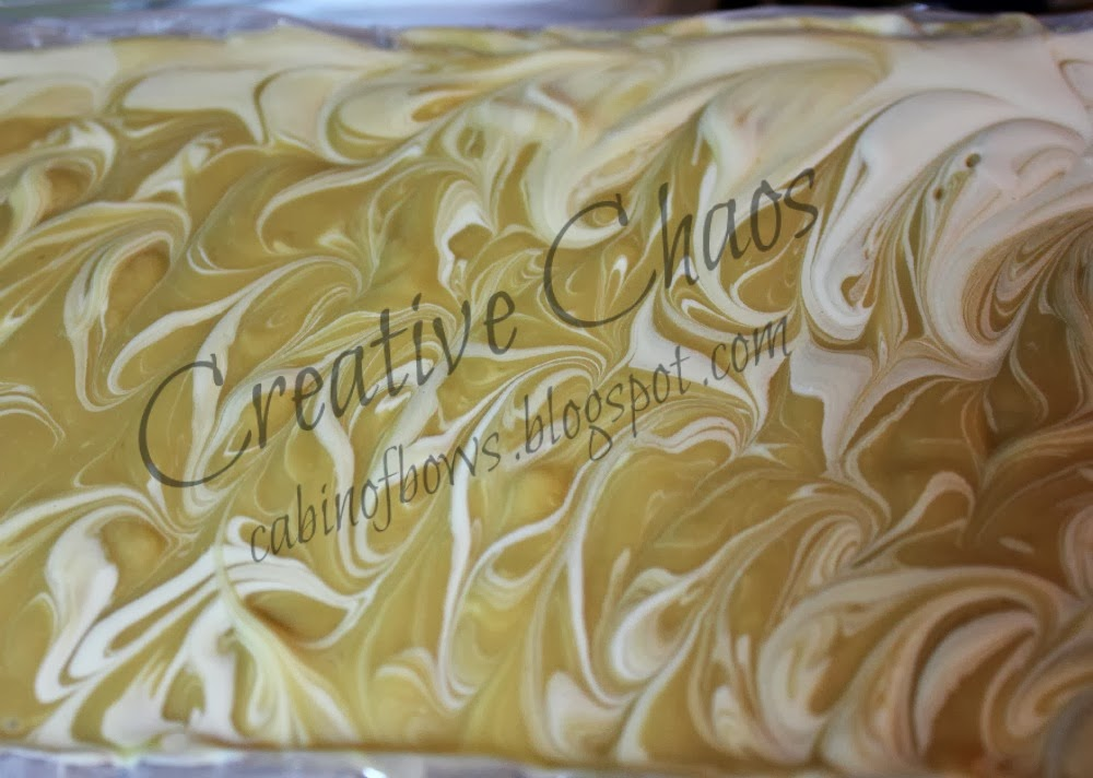 feathery swirls on top of handmade soap