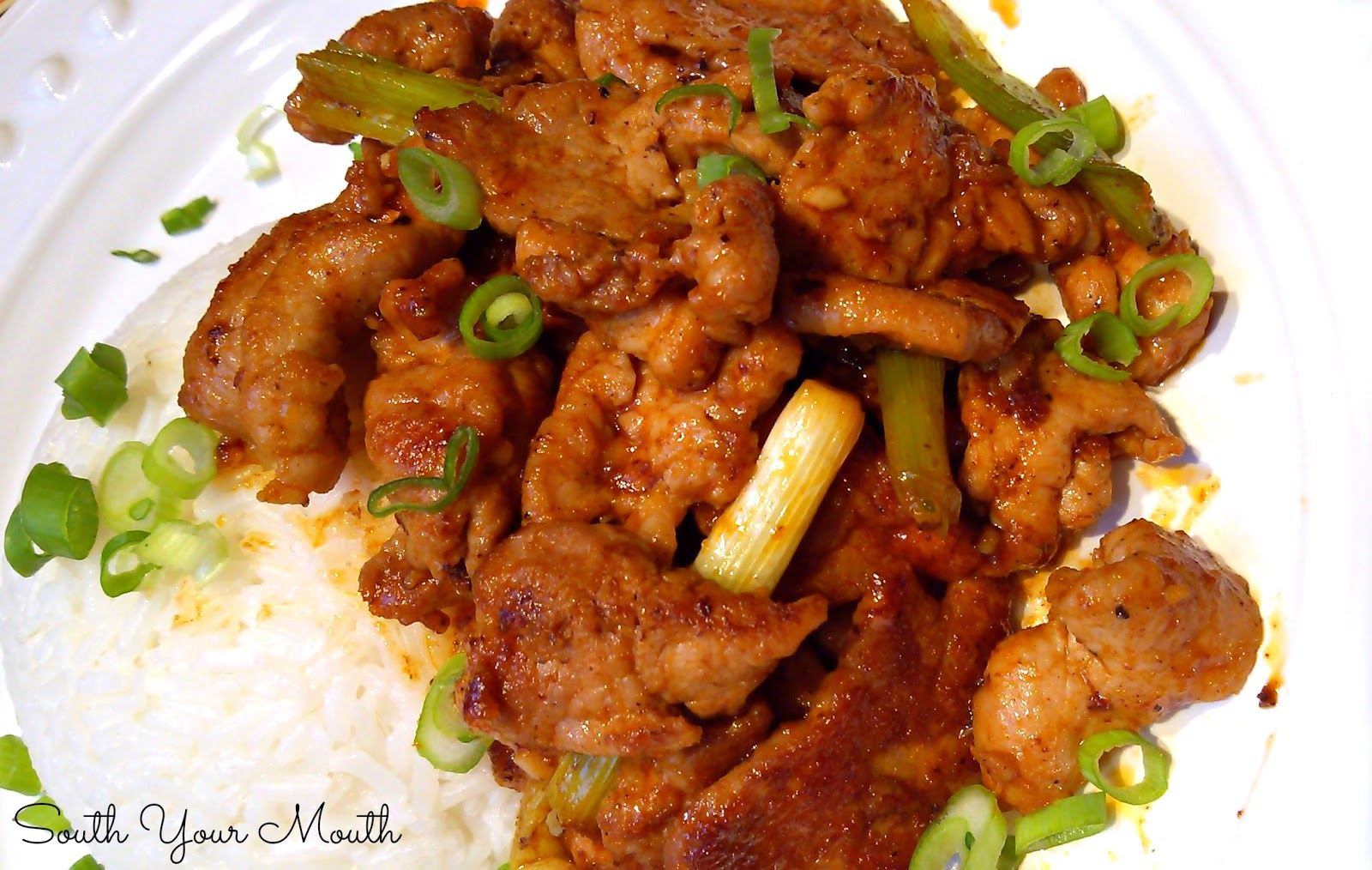 Korean Spicy Pork: Spicy strips of pork with sriracha, ginger, garlic and onions.