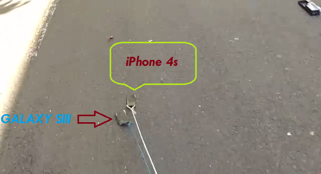 iPhone 4s VS Galaxy SIII diseret dibelakang mobil [Video]