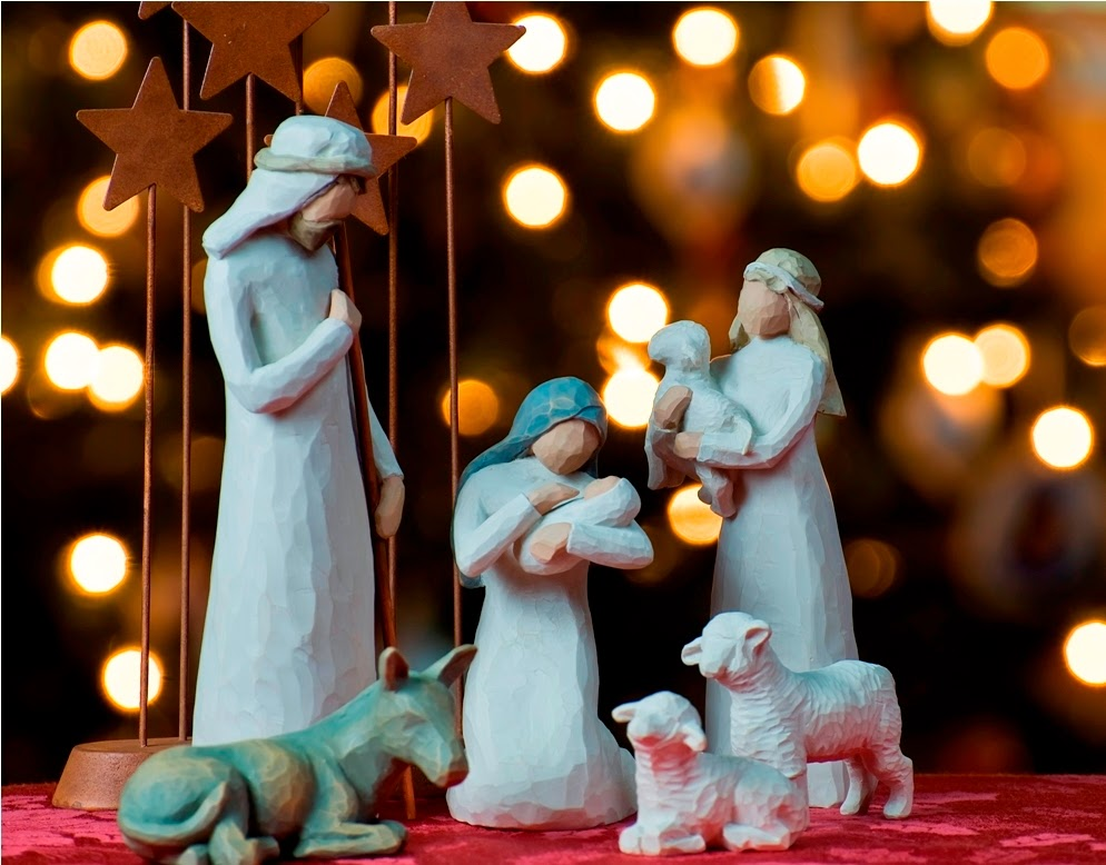 A depiction of the Nativity with a Christmas tree backdrop
