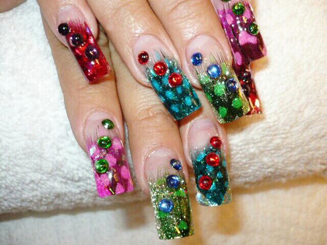 Foto Uñas Decoradas Bellas uñas con diseño de plumas, muy lindas