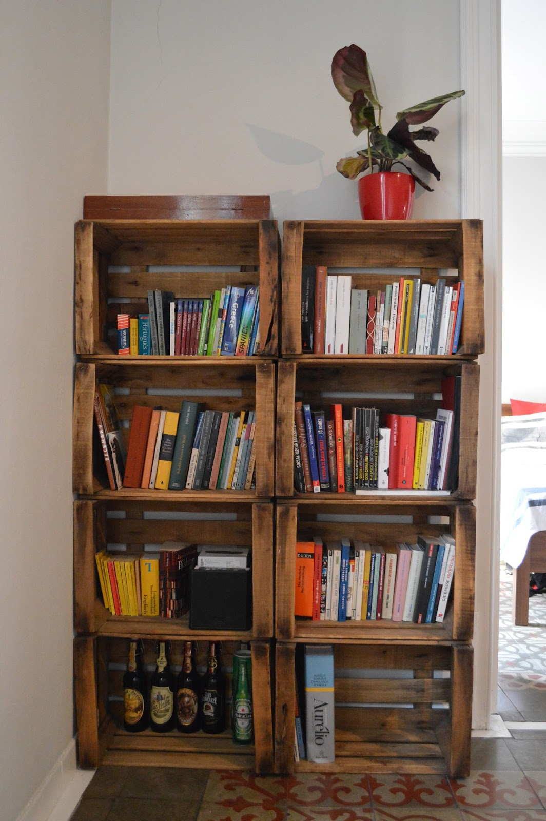 Recycled old vintage retro vegetable crates made into bookshelves in Airbnb apartment Barcelona