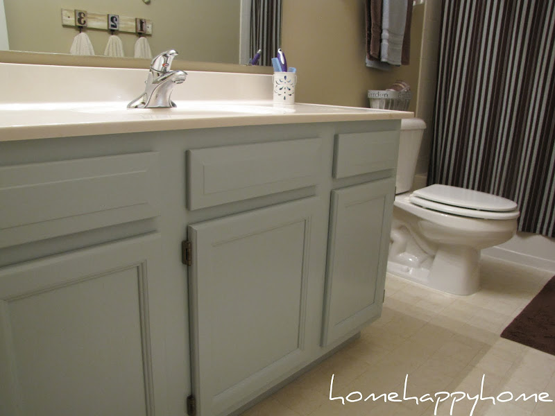 Painting oak cabinets is such an easy fix and makes a huge difference. title=