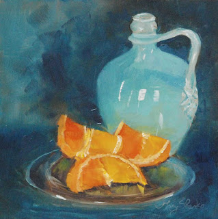 still life oil painting of a blue jug and oranges by Mary Benke