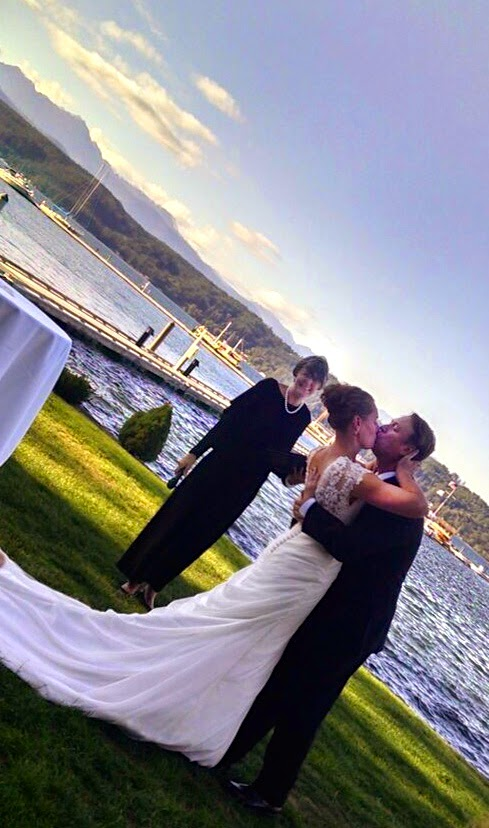 Scott and Brigitte kiss during their wedding ceremony at Alderbrook Resort.  Patricia Stimac, Seattle Wedding Officiant.