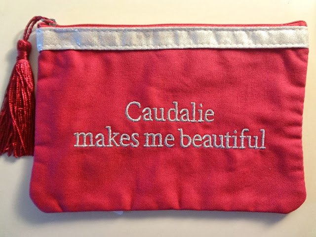 Caudalie pink makeup bag
