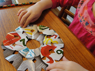 child's paper snowflake displayed on table