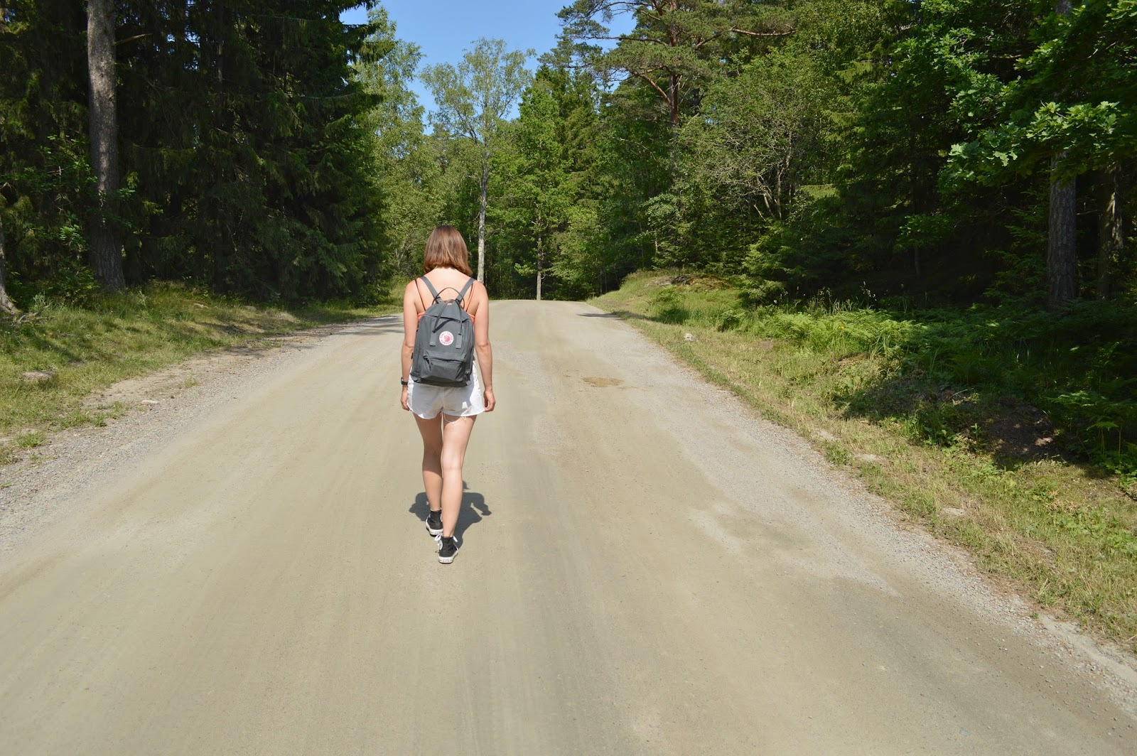 Me walking through forest in Utö Stockholm archipelago, Kanken backpack