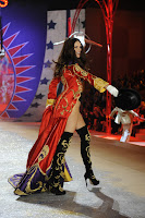 Adriana Lima on the runway in knee high boots