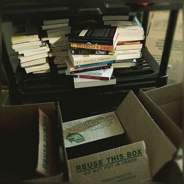 books on the shelves to be boxed and donated book purge The 3 Rs Blog