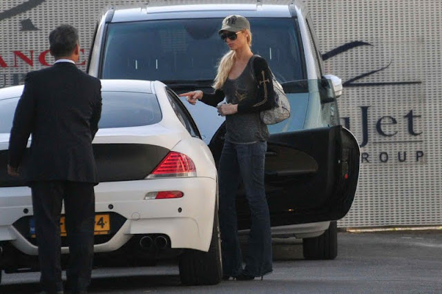 Paris Hilton with her car