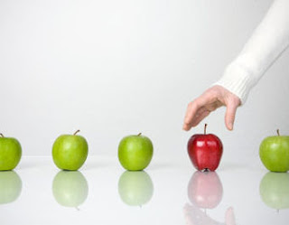 Picking a red apple out of a line-up of green ones