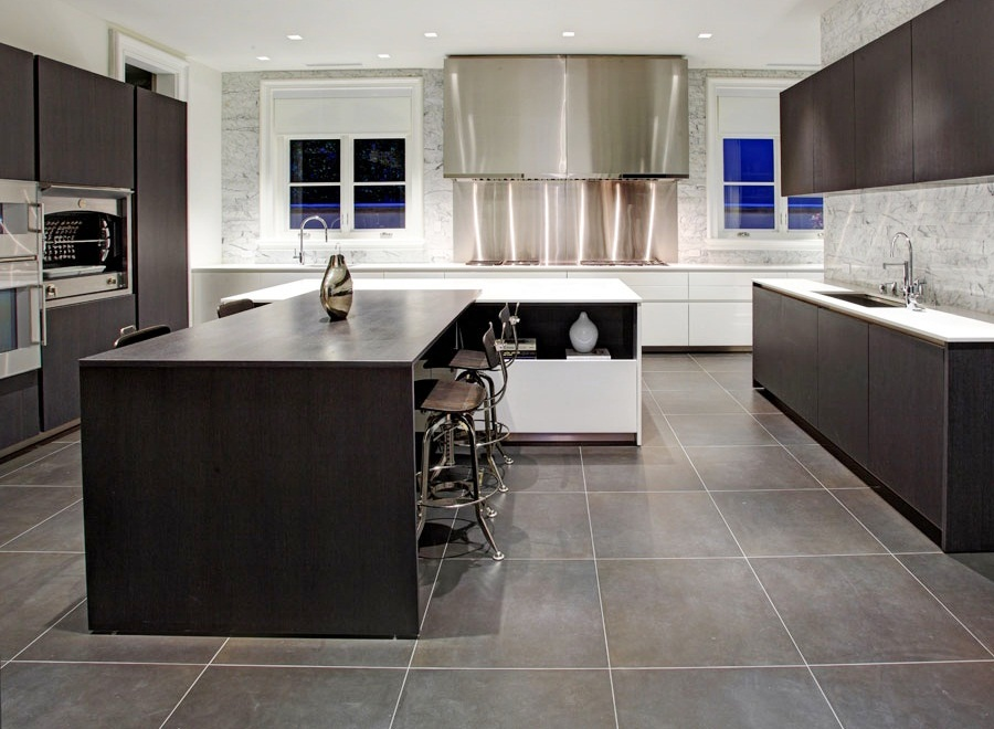 very modern kitchen with large square slate tile flooring, sleek
